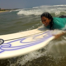 A happy surf student getting a feeling for the waves