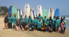 Our happy beach cleanup and environmental group after a surf session together